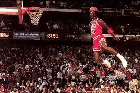 """Michael Jordan flying through the air for his famous """"air jordan"""" dunk."""