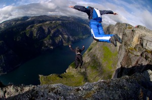 Base jumping from a cliff.