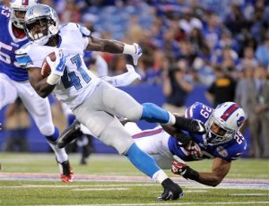 Detroit Lions running back Theo Riddick (41) is tripped up by Buffalo Bills cornerback Ross Cockrell (29) during the first half of a preseason NFL football game, Thursday, Aug. 28, 2014, in Orchard Park, N.Y.