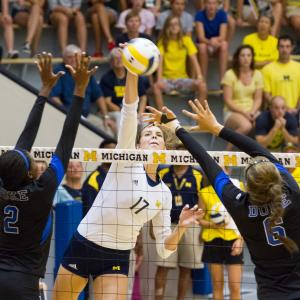Michigan's middle hitter, Abby Cole, up against Duke's Jeme Obeime (OH) and Alyse Whitaker (MH) at the game on September 5th where Michigan won in a close 5 sets!