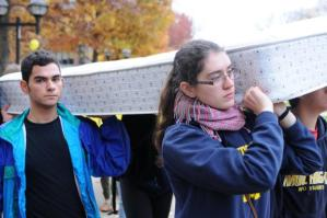 LSA sophomore Anna Kreiner and LSA freshman Darian Razder carry a mattress across the Diag to raise awareness about sexual assault on college campuses as part of the Carry That Weight campaign in solidarity with Columbia University junior Emma Sulcowicz.