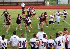 Powderpuff game where men and women exchange traditional roles at a sporting event.