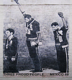 Tommie Smith and John Carlos on the medal stand with their fists raised.