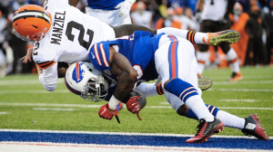 Johnny Manziel hurtles into the end zone against the Bills last Sunday.