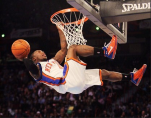 Nate Robinson performs an incredible dunk during a New York Knicks game.